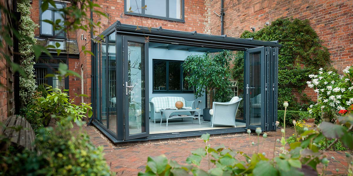 Modern Grey Conservatory With Bi Folding Doors