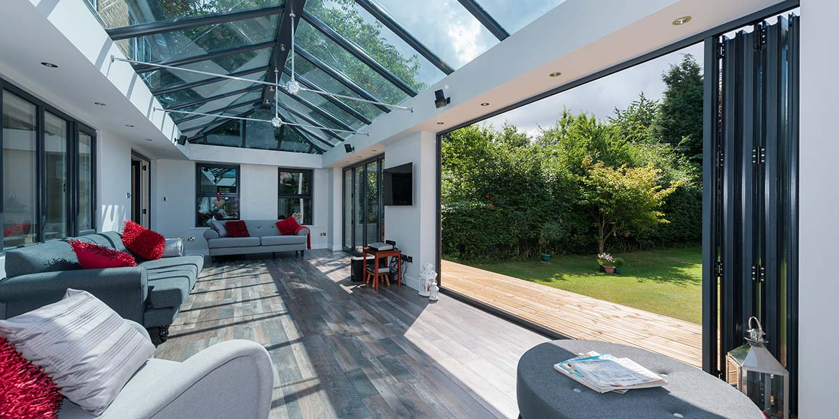 modern grey orangery featuring bi folding doors