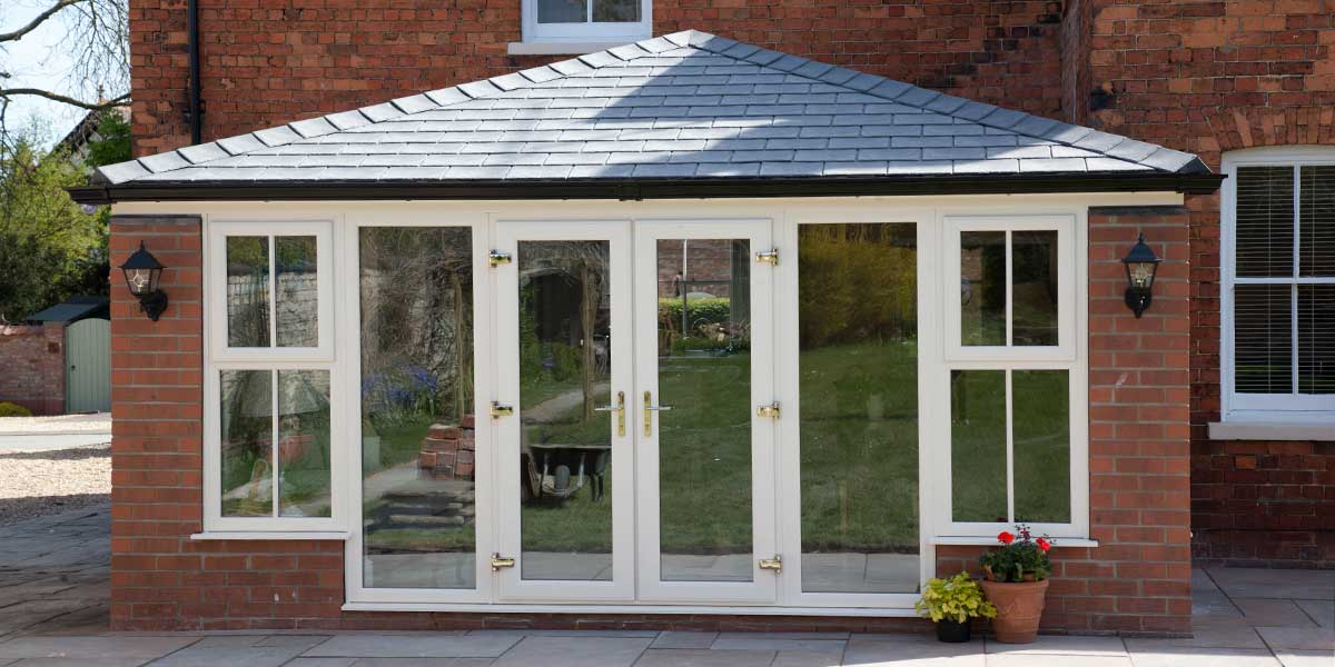 Solid tiled roof orangeries from permaframe solid tiled for Orangery lighting ideas